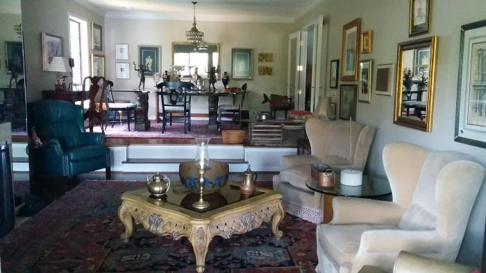 "This is a view of the sunken living room, showcasing the Antique Serapi, walls that look like a NY apartment, huge Galle bowl, upholstered armchairs, MCM round wooden table, with 1"" thick glass top and a very dated, but comfy leather recliner."