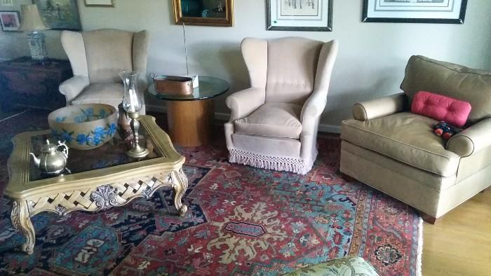 The pair of wingback chairs feature down cushions, the taupe leather armchair is from the Grizzel & Mann showroom in ADAC. That Gawd awful coffee table was found in South Atlanta, on the curb, so we dragged it to Berkeley Lake to give it a good home...   ;-)