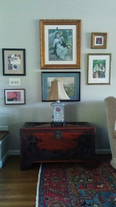 Hand carved Asian chest, with decent porcelain lamp and all original artwork on wall.