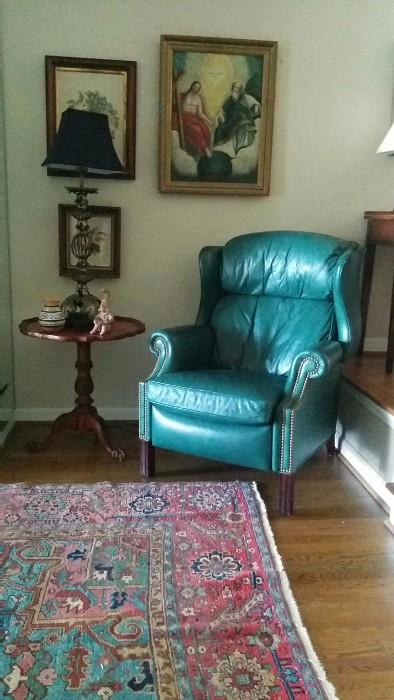 Teal green leather La-Z-Boy recliner, early 19th century religious right oil painting, pair of wooden framed embroidery.                                                                                I had to include another shot of that gorgene Serapi.