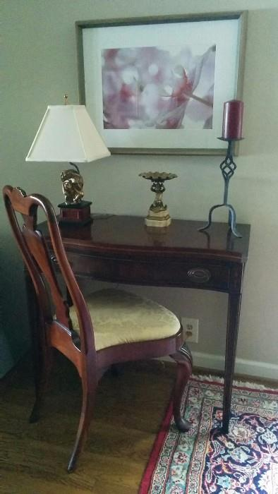 1940's mahogany game table, with a distant relative mahogany chair, original photography by Marilyn Suriani - Orchids - antique brass putti holding a shell, on white marble base; funky monkey lamp.