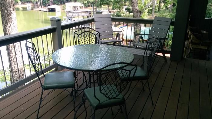 Wavy glass-topped wrought iron table, w/4 matching chairs.