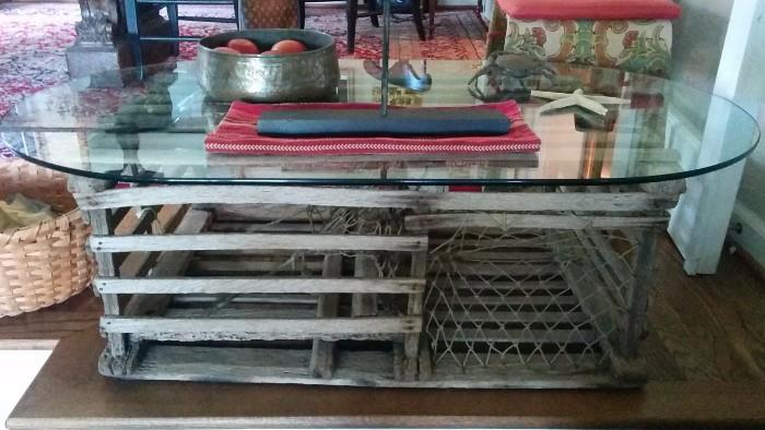 Here ya go! The purrrrfekt accessory for the lake: a vintage lobster trap, made into a coffee table.