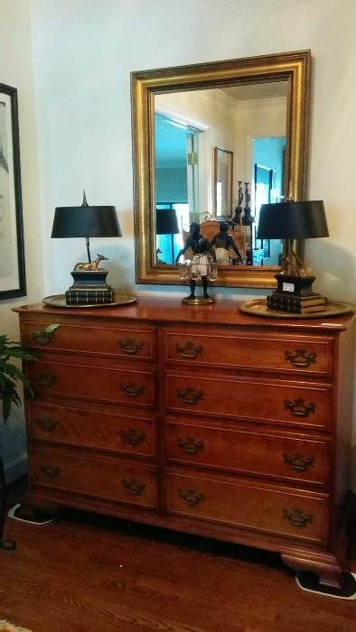 """A vintage 8-drawer Stickley """"Cherry Valley"""" chest, with a pair of 1973 vintage Chapman L/R facing brass greyhound table lamps.                                                               The real find is the Petit Choses blackamoor, with three glass vases."""