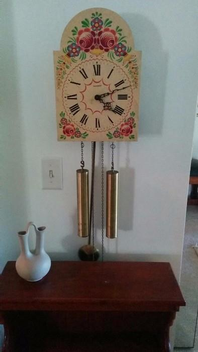 Swiss Bucherer wall clock, with very pleasant chimes. Pigeon Forge Pottery double-neck vase.