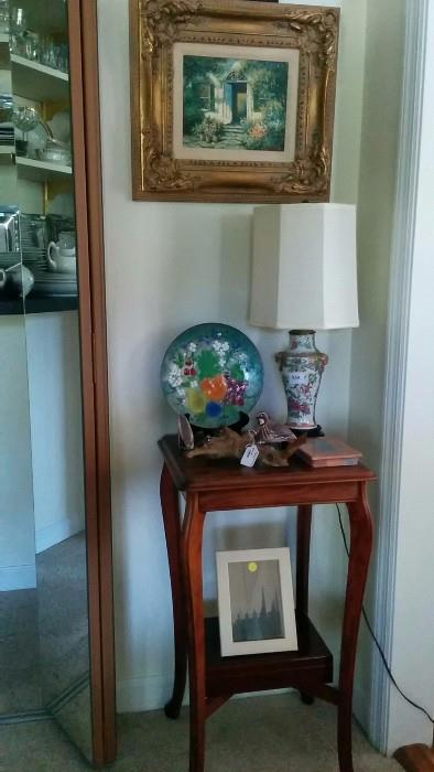 Original oil painting in wooden frame, antique mahogany side table, cute Asian lamp, Mama Quail + 2 quail-ettes on a driftwood branch, wooden humidor below, and a framed pic of something boring. oops, almost forgot the enameled metal tray on plate stand.