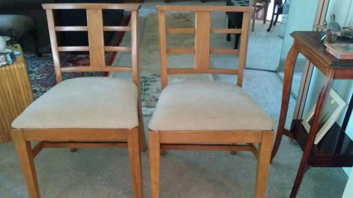 Two of the four chairs - love the MCM design and use of ribbon mahogany.
