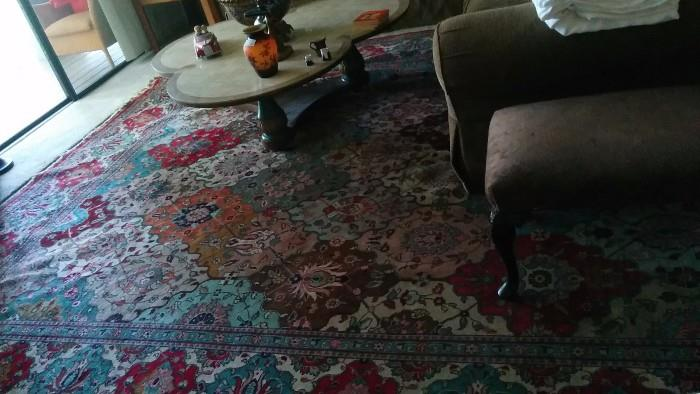 Persian rug in the den - love the riot of colors!