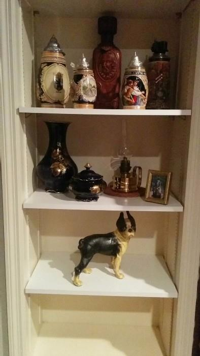 A collection of German beer steins, a heavy French oil lamp and a vintage cast iron Boston Terrier - aww, so cuuuute!
