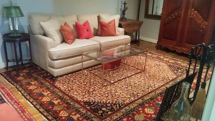9' x 11' handwoven Persian rug, 100% wool. Queen size sleeper sofa by La-Z-Boy, featuring an air mattress that self inflates - very cool when that unexpected family member arrives, after having escaped from prison - again; brass Esther table, with beveled glass.