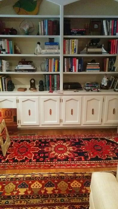 Bookshelves crammed with books, well, what did you expect?!? Oh and there's some vintage cast iron goodies, R.S. Prussia plates, bowls and trays, Roseville, vintage barware, etc.                                                                    Don't miss the Persian Heriz runner!