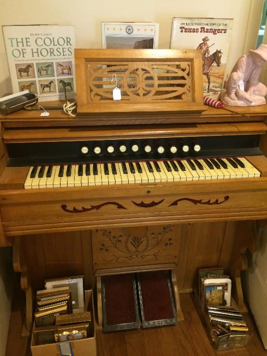 Pump organ; Western books; many picture frames