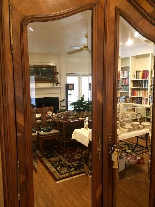 Antique mirrored armoire