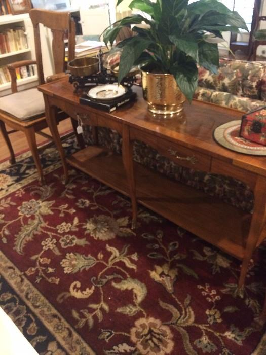 Sofa table; large rug; antique chair