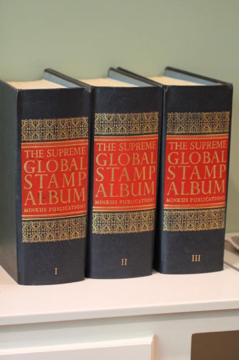Global Stamp Album volumes I, II and III (with a few stamps mounted inside)