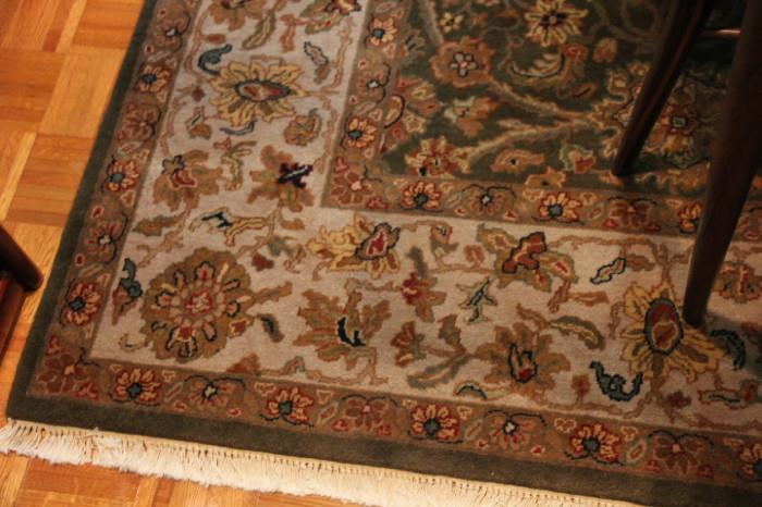 hand-tied rug in dining room
