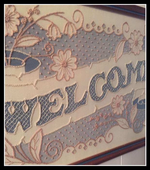 Candle wick and crewel embroidery Welcome sign