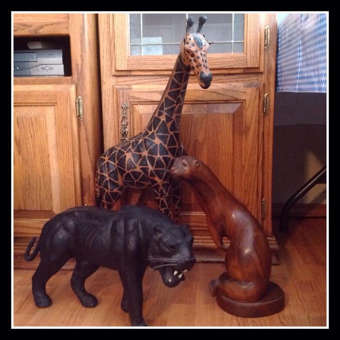 Large wooden panther, giraffe, seal