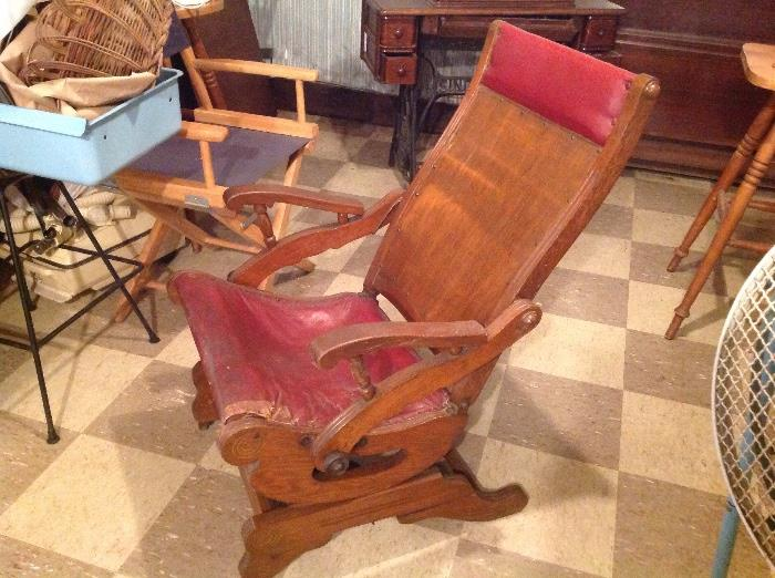 Antique wooden rocker with leather seat and headrest...wood in very good condition, leather in fair condition