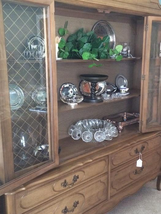 Large china cabinet-matches the dining table;            2nd shelf - Southern Living barley twist cake plate