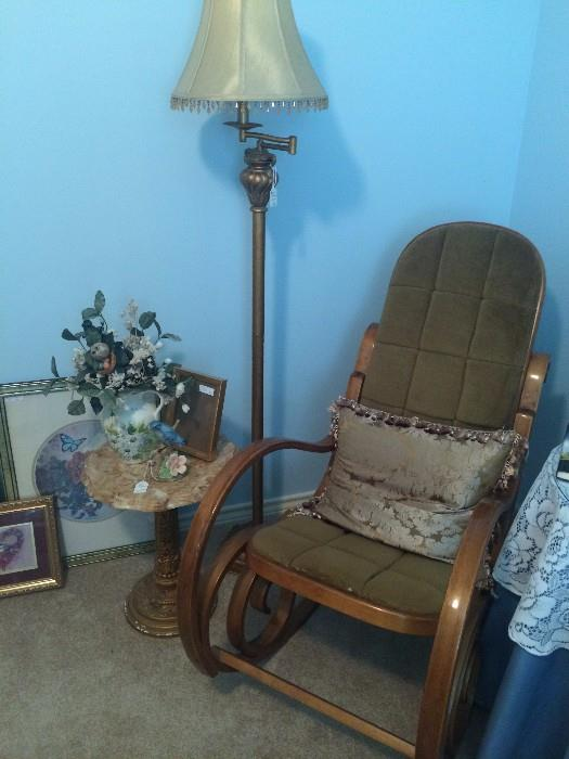 Bentwood rocker, floor lamp, and small marble top table