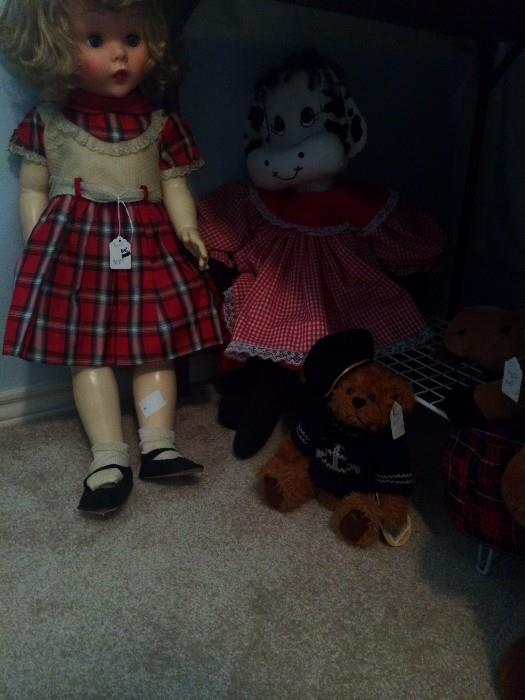 Several dolls & stuffed animals