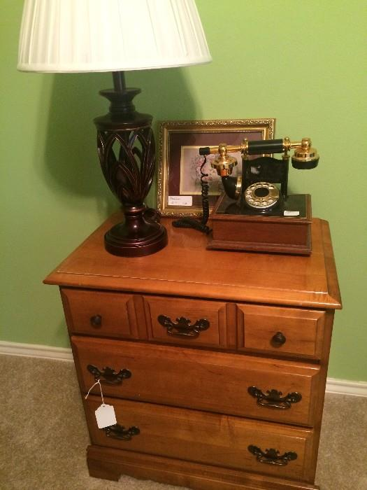Three drawer nightstand (has matching dresser), lamp, and unique phone,