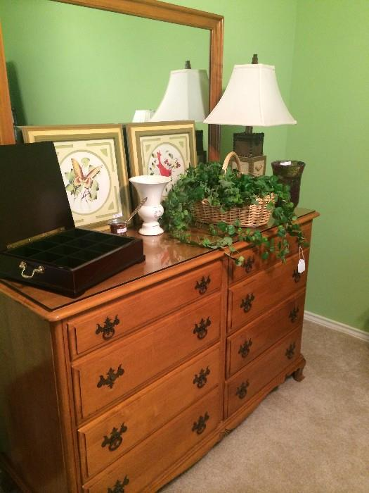 Eight drawer dresser & mirror has matching nightstand.