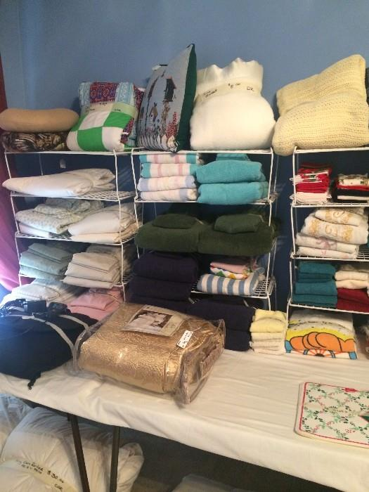 Lots of linens, pillows, & bedding