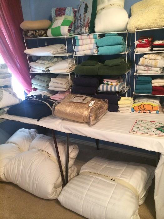 Lots of linens, pillows, bed covers, & bedding