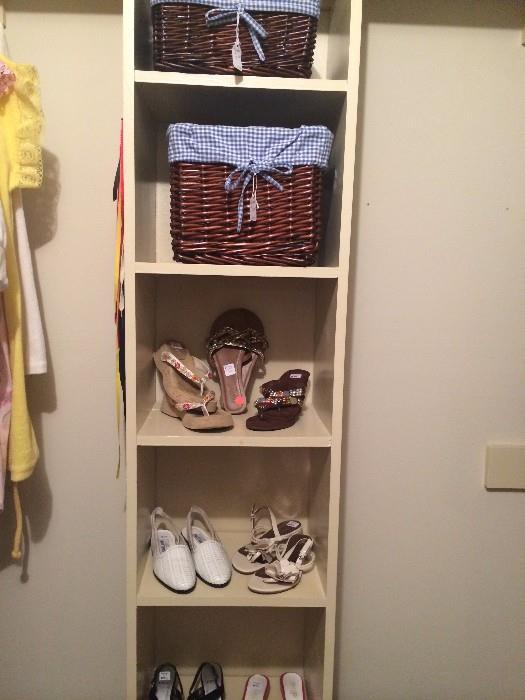 Some of the many shoes; basket organizers