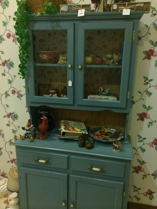 Blue hutch, cookbooks, decorative roosters & fruit