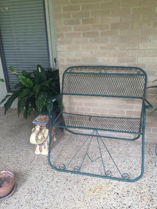 Green patio settee; small elephant plant stand