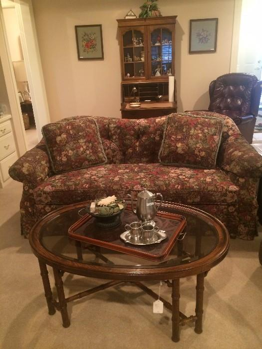 Sofa has matching chair; oval glass top coffee table; pewter tea set