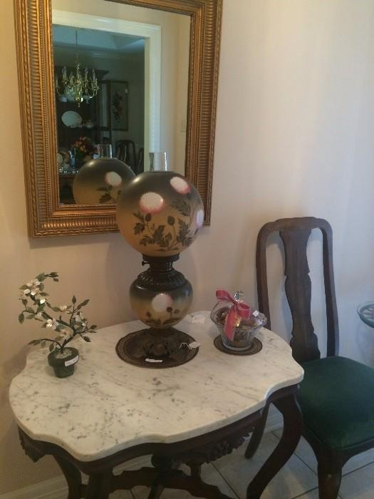 """Antique marble top table; """"Gone With the Wind: lamp; 1 of 2 antique chairs"""
