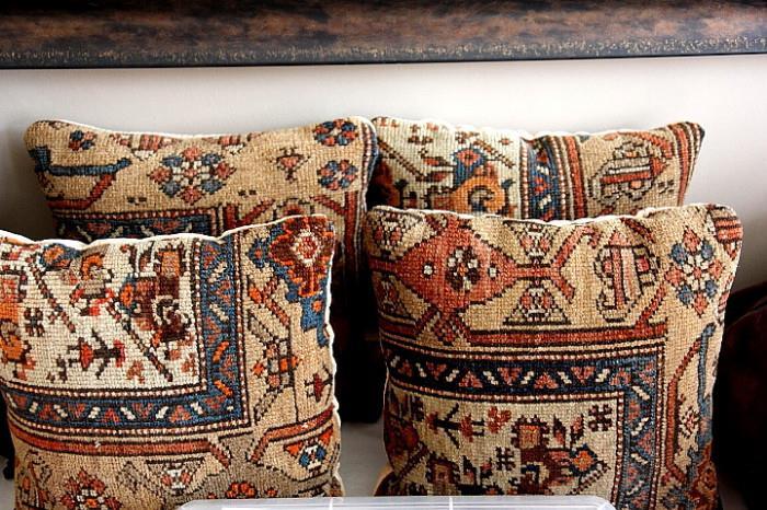 matching pillows made from an antique Persian carpet