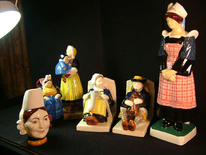 Part of a collection of Quimper including figural jugs, book ends, statues etc.