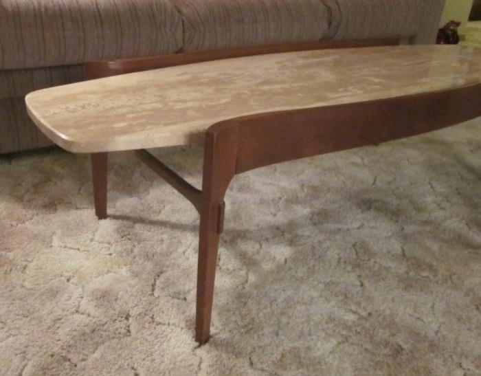 Mid Century Modern surfboard coffee table by high-end furniture company, Gordon's Fine Furniture.  Curved walnut base with floating travertine top from Italy.