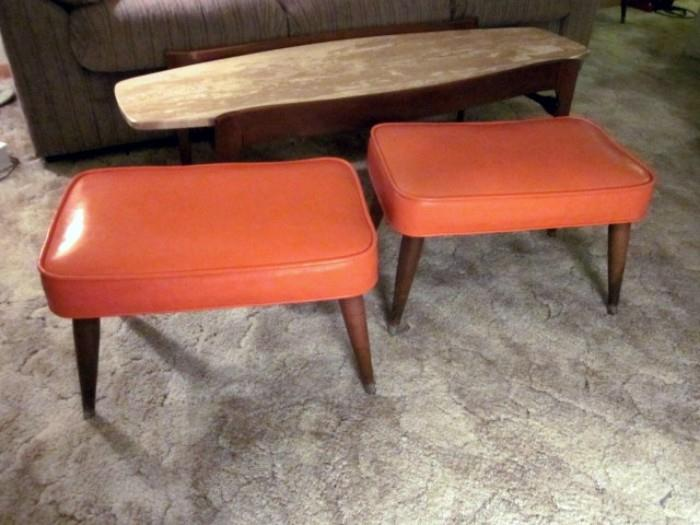 Pair of Mid Century Modern ottomans/footstools by Bobcock Phillips.  Orange vinyl, pencil legs with brass tips.