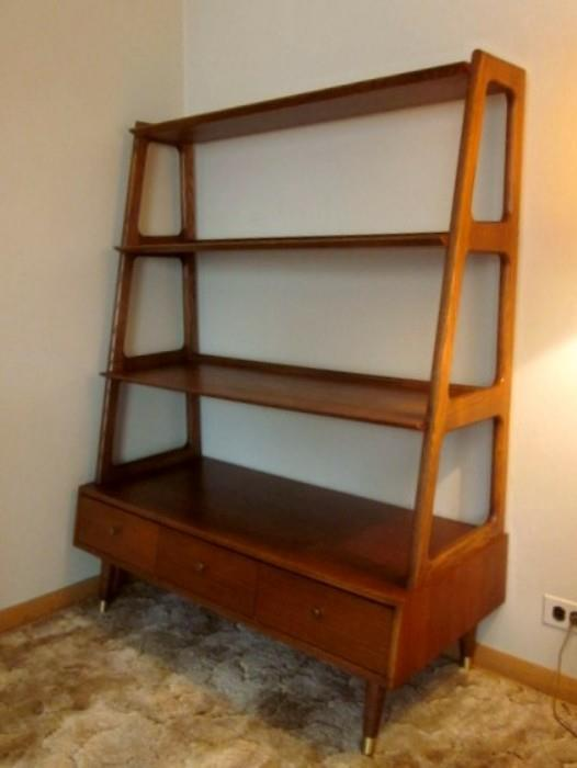 Mid Century Modern - Danish, angular shelving unit with three drawers, pencil legs with brass tips, by Saginaw Furniture.  Amazing and in great condition!
