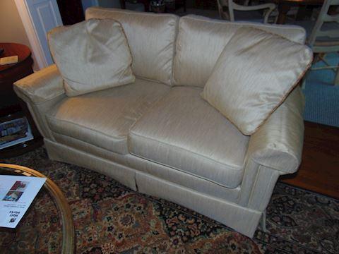 Silk upholstered love seat