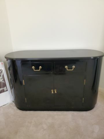 Black lacquer side table with brass handles