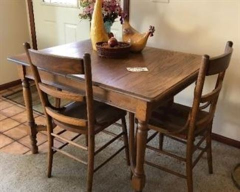 Oak dining table with 3 chairs