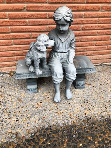 105.  Yard.  Boy and Dog on Bench Statue
