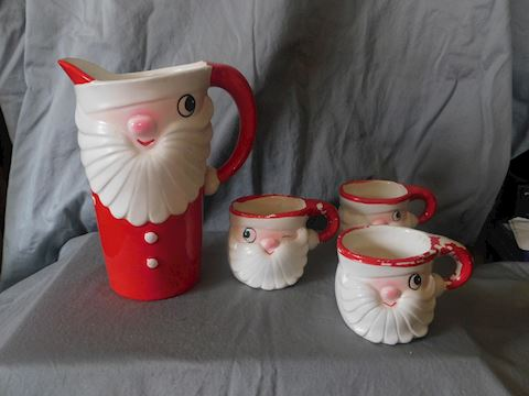 Winking Santa pitcher three mugs