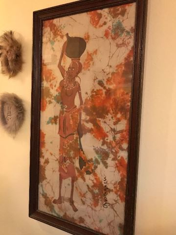 large art (fabric?) with frame