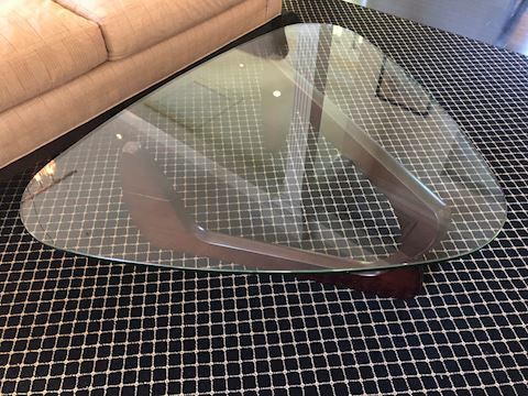 Triangle glass coffee table