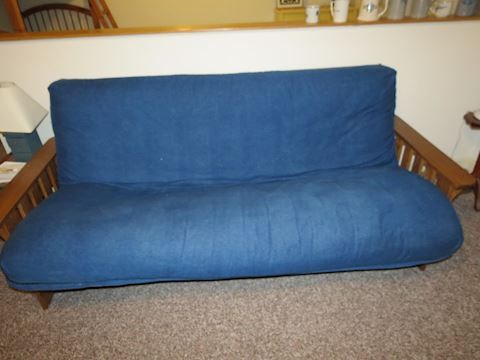 Futon with Blue Cushion