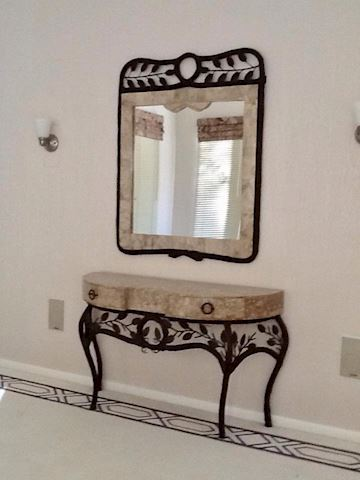 Mirror on top of side table
