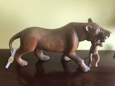 Hand carved wood African Lioness